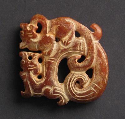 sculpture jade rouge antiquite bijou dragons entrelaces chine